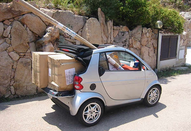 Who needs a pick up? An entire set of Farr 40 sails, including battens, get their own chauffer driven Smart Car
