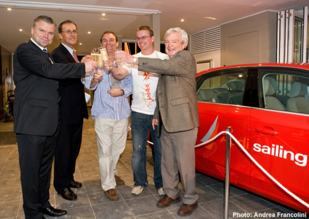 Ben Nossiter (right) with new red car