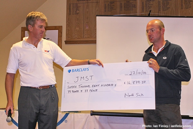 Ian Walker receiving the big cheque on behalf of the JMST from North Sail's Neil Mackley