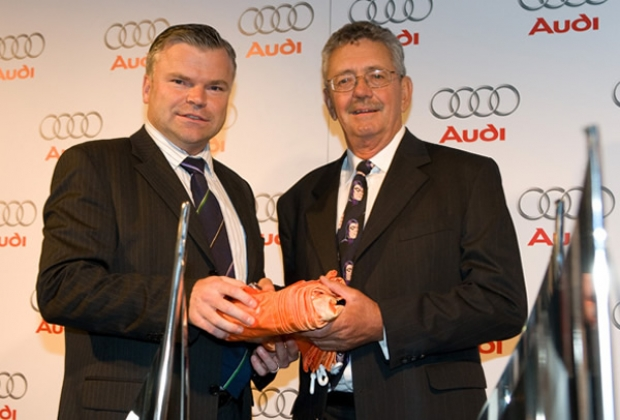 Peter Sorensen accepts the 'orange flag' from Audi MD Joerg Hofmann