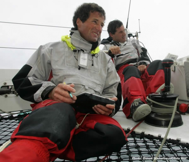 Michel Desjoyeaux (with tablet PC) and his TJV co-skipper Hugues Destremau at the helm