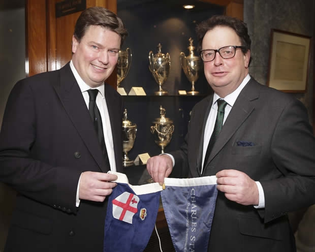 Chris Dawson, Commodore of the Royal London Yacht Club (left) exchanging pennants with Mike Lilwall, Director of Charles Stanley Group PLC