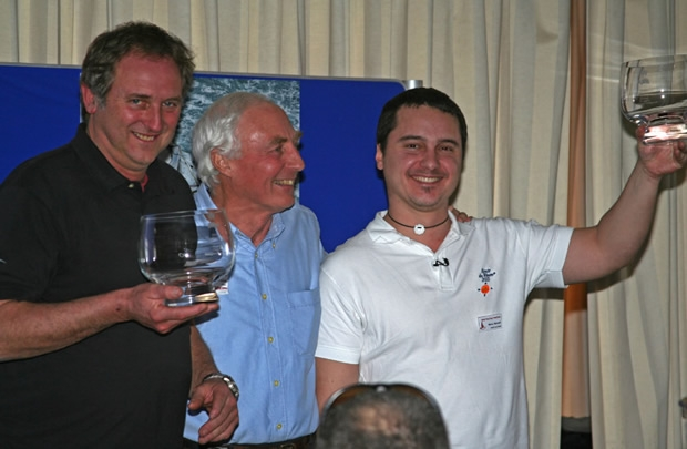 "Paul Peggs and Marco Nannini accept their Round Britain prizes. Marco Nannini: ""What they don't tell you about the Round Britain is all the drinking. These were the shot glasses!"""